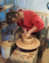 The next step in wheel throwing pottery is opening the clay body.